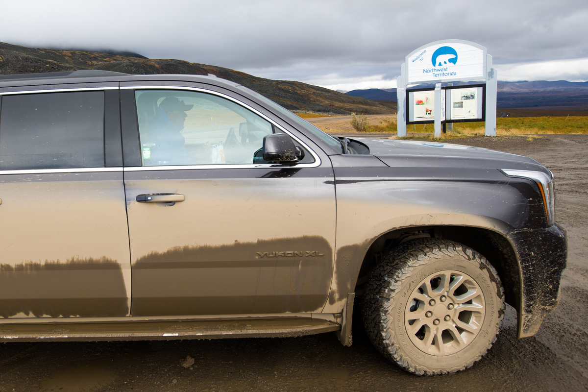 dusty cars are a hallmark of driving the dempster