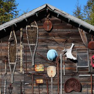 Snowshoeing and fishing gear on a cabin in the Woodyard in Yellowknife