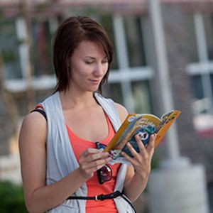 Woman reading arctic aurora borealis itinerary for the Northwest Territories