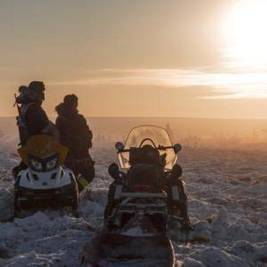 snowmobiling at sunset in Inuvik