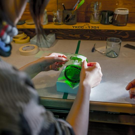 applying design in sandblasted glass workshop