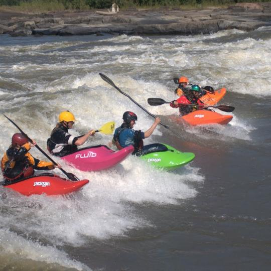 Kayaks in the Slave River Paddlefest