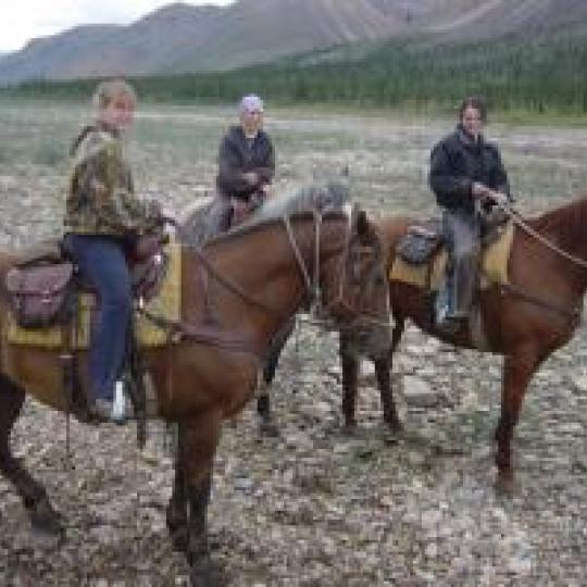 Three people on horseback at Gana River Outfitters in the Mackenzie Mountains of the NWT