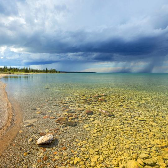 beautiful lake with storm in distance