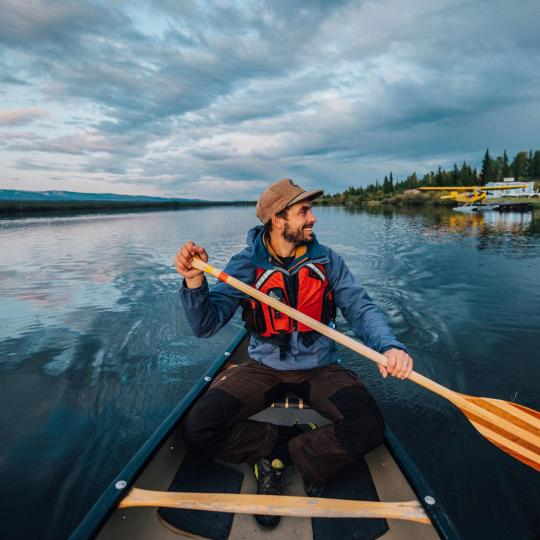 A man paddles down the Mackenzie River