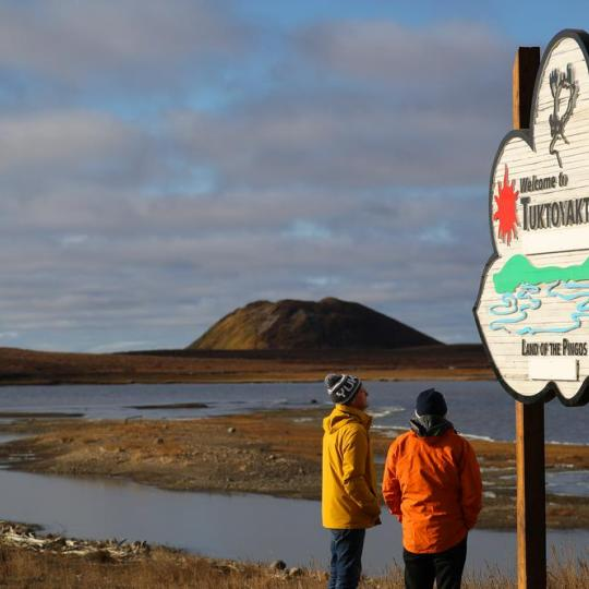 Sign of Tuktoyaktuk with pingo in the background