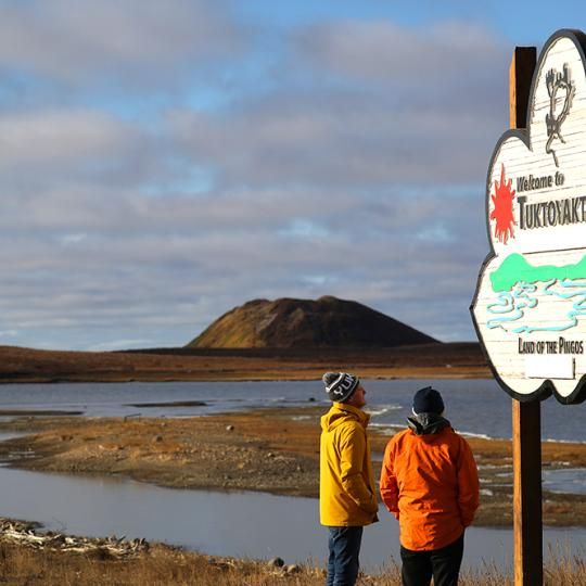 Welcome to Tuktoyaktuk sign with Pingo in the background