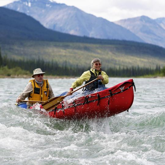A couple barrel down the nahanni river