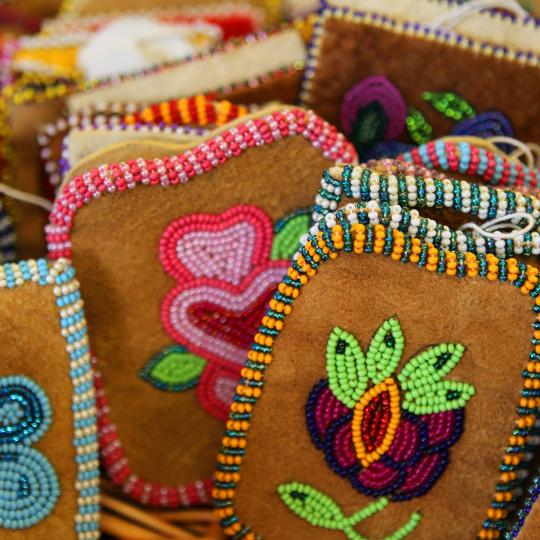 Colourful beaded moosehide pouches created by Tlicho artists in the NWT