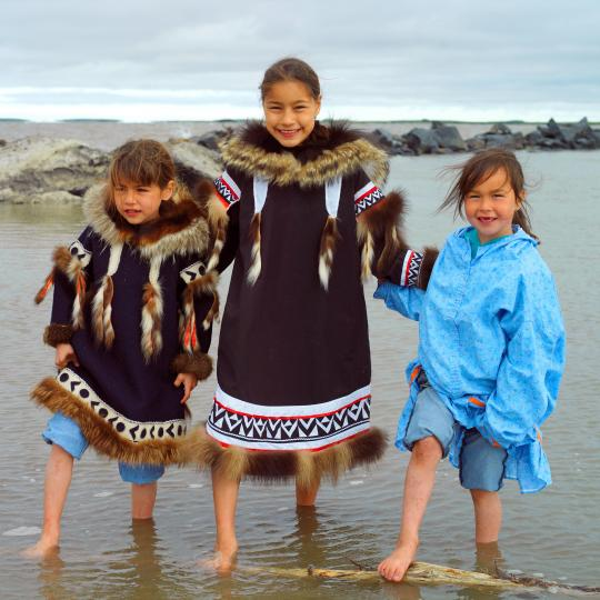 3 girls standing in the arctic water