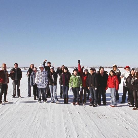 A group of tourists on a winter tour in Yellowknife, Northwest Territories.