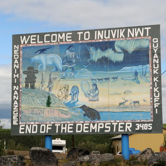 The road sign marking the end of the Dempster Highway in Inuvik, Northwest Territories, Canada