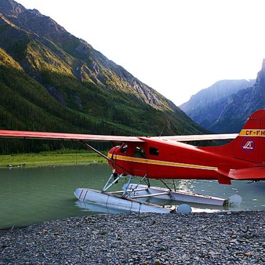 Simpson Air red float plane lands on Little Doctor Lake in the NWT in the Nahanni National Park.