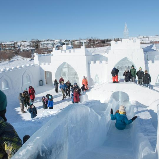 A crew of Yellowknifers builds a snowcastle on Great Slave Lake's Yellowknife Bay in Canada's Northwest Territories