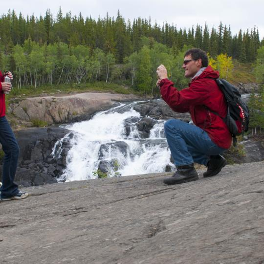 couple taking photograph next to cameron falls