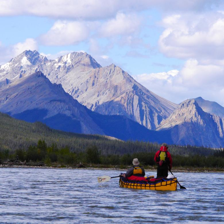 paddling with a mountain view on the Mountain River, NWT, with Black Feather