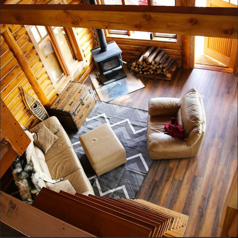 Overhead view of Ten Stone Mountain Lodge brightly lit living room in the Sahtu region, NWT