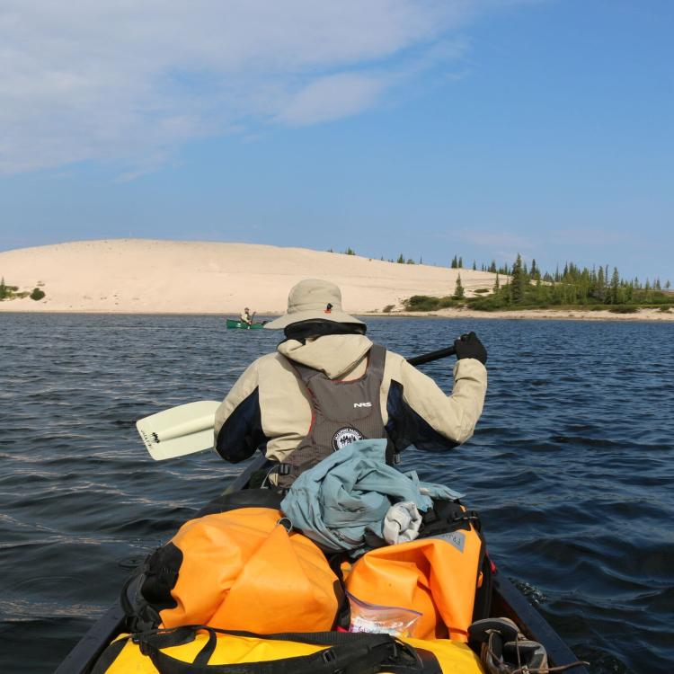 A man's back paddling on a Jackpine Paddle - Thelon River tour in the Northwest Territories.