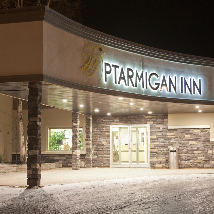 Ptarmigan Inn Front entrance aglow at night in Hay River in the Northwest Territories.