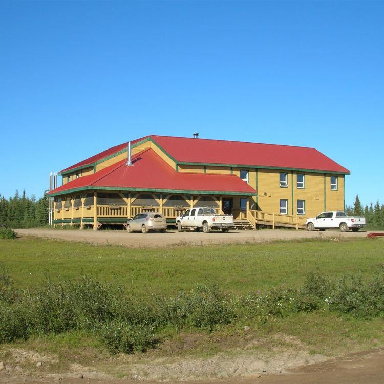 Grey Goose Lodge with brick red colored roof in Deline in the NWT.