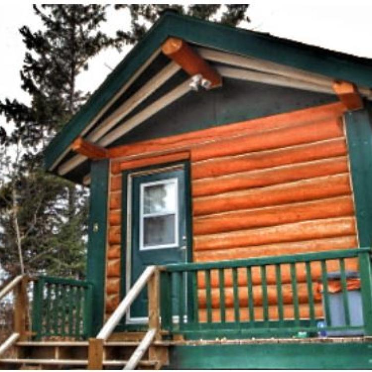 Whispering Pines Cottages exterior look of wooden cabin in Fort Smith, NWT.