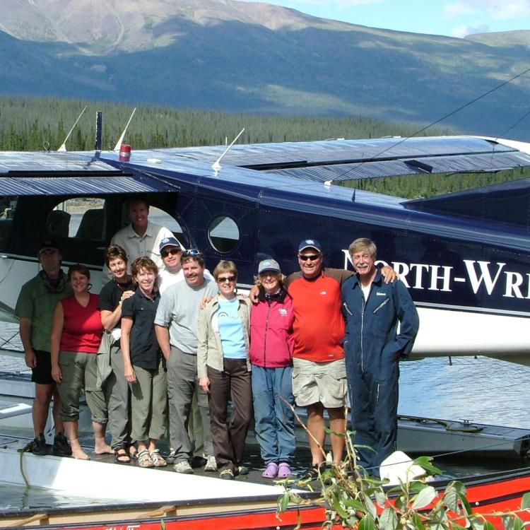 North-Wright Airways Ltd. twin otter bush plane with a gruop of people standing in front, happy, on a sunny day in the Northwest Territories.