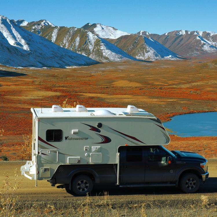 Fraserway camper on truck driving in the Yukon in northern Canada.