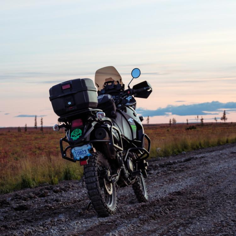 Arctic Motorcycle Adventures with a motorcycle parked at sunset in the Western Arctic Region of the NWT.