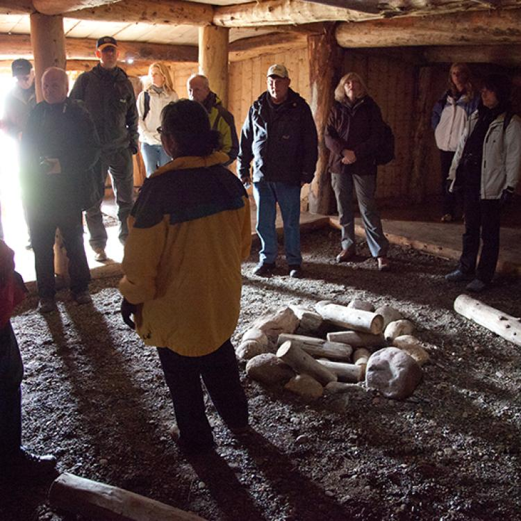 The interior of the sod house in tuktoyaktuk with people on a tour