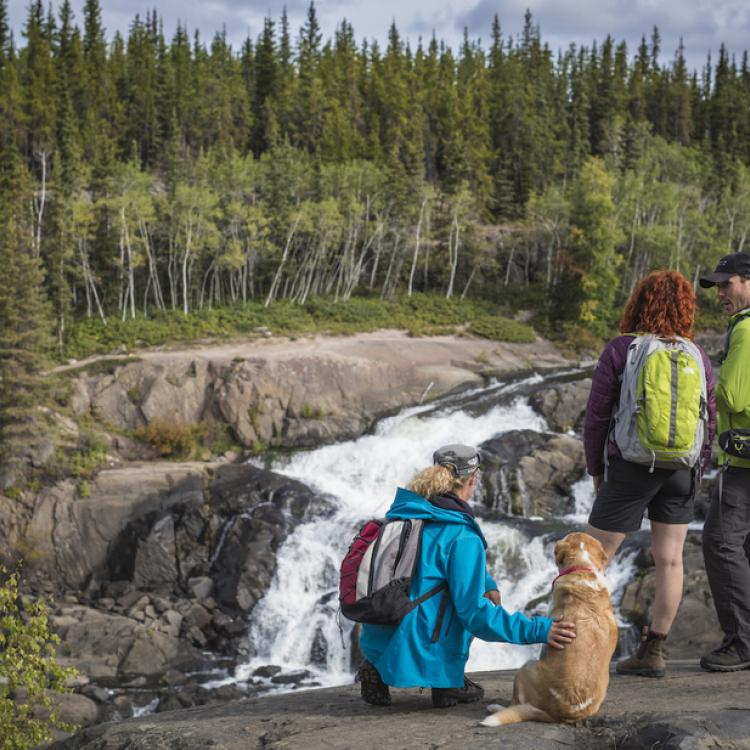 Hikers at Cameron Falls on the Ingraham Trail in the NWT