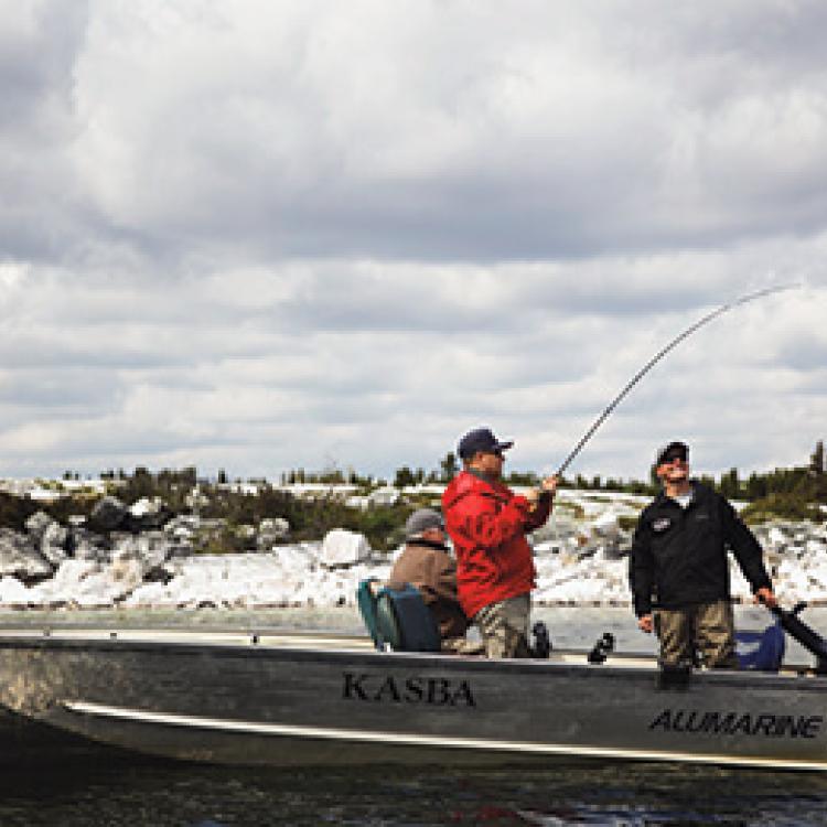 Two men in boat lake fishing