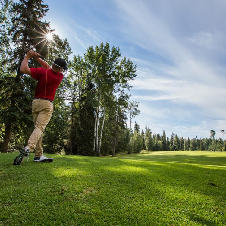 Golfer at hay River Golf Club in the Northwest Territories