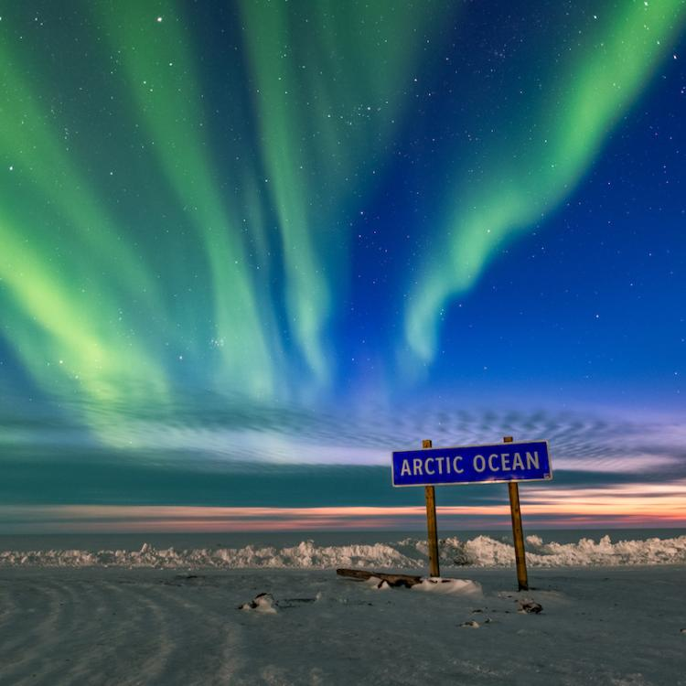 Aurora northern lights dance the Arctic Ocean sign in the NWT