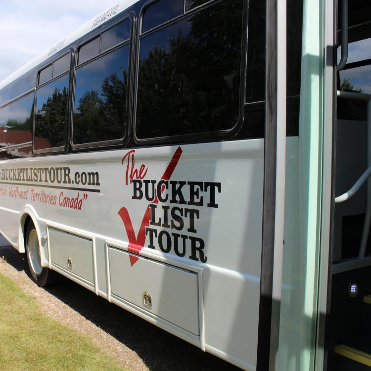 Bucket List Tour Company luxury coach bus with logo in Yellowknife Northwest Territories.