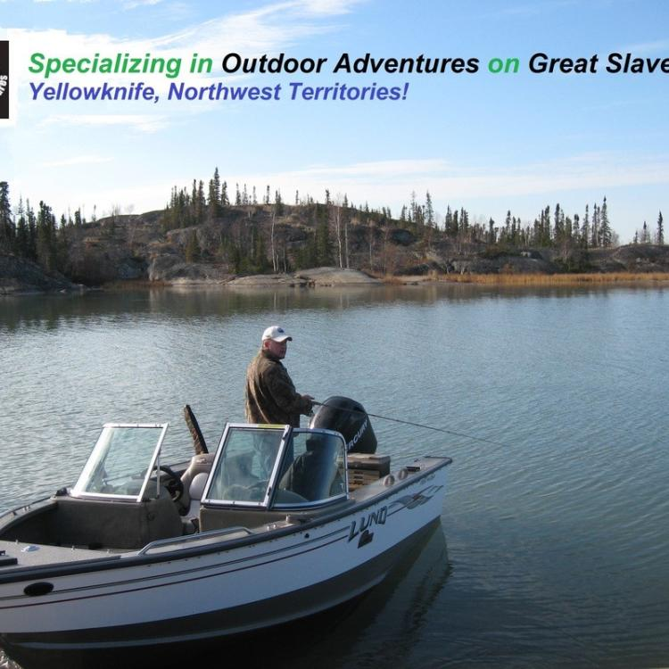 Great Slave Adventures image of man on boat on the Great Slave Lake in the Northwest Territories.