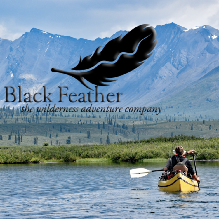 Black Feather - the wilderness adventure company logo with picture of a yellow canoe and a paddler in the Nahanni National Park.