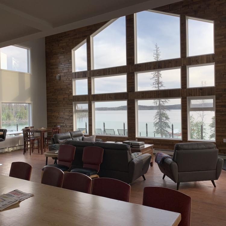 Namushka Lodge looking from the kitchen to the main windows sunlight in Northwest Territories.
