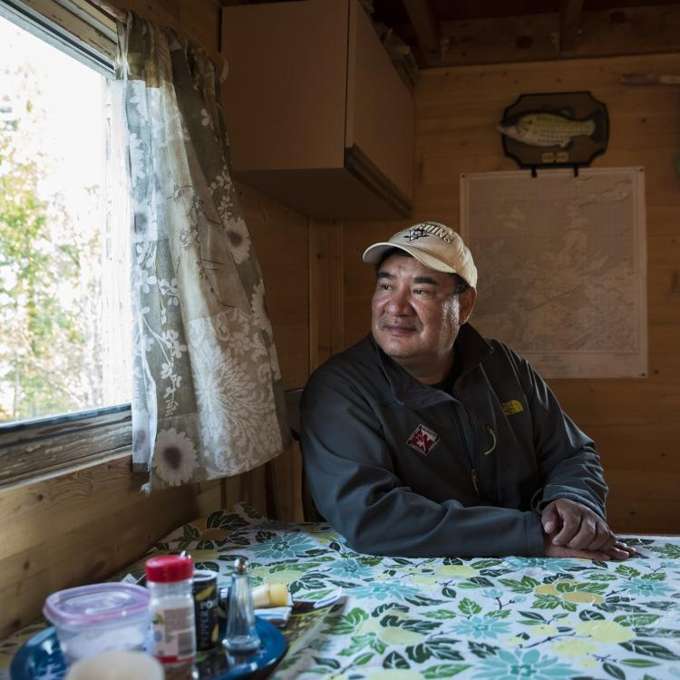 James Marlowe from River's East Arm Tours looking out the window of his cabin in Lutsel K'e, Northwest Territories.