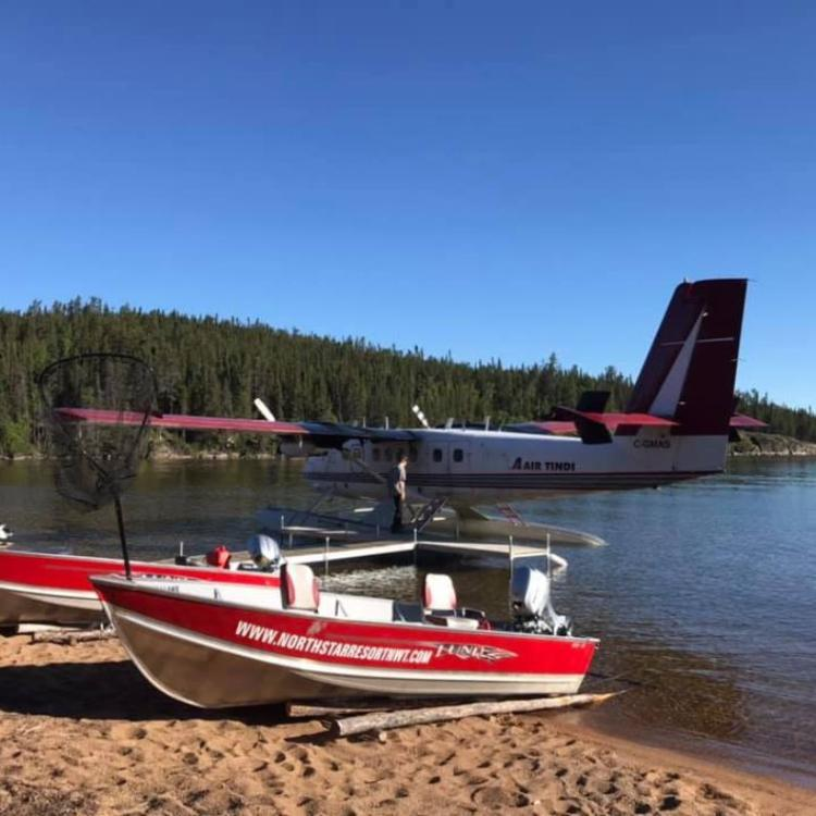 Two North Star Resort boats on the sandy beach of Thekulthili Lake near Fort Smith, NWT.