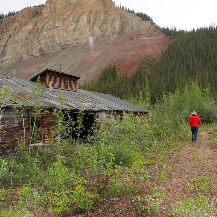 an abandoned building along the canol trail