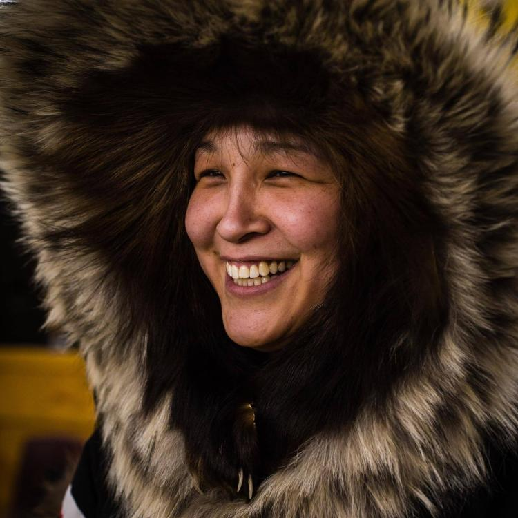 Inuvialuit inuit woman wearing a halo parka