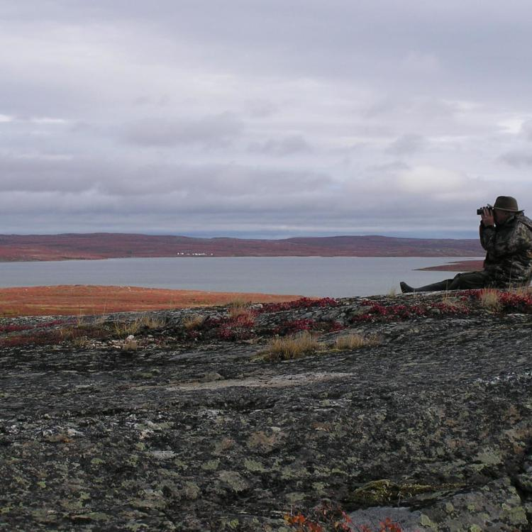 Arctic Safaris man taking a photo in the Barrenlands in the Northwest Territories.