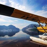 North Star Adventures yellow float plane on Mackenzie River in Dehcho region NWT.
