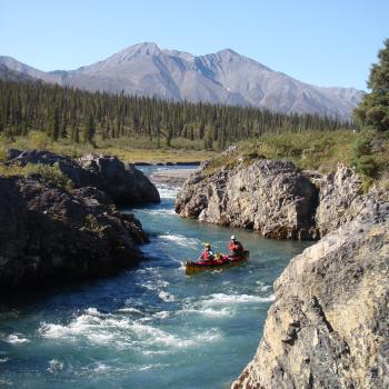 paddling rapids on the Mountain River, NWT, with Black Feather