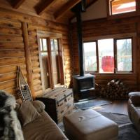 View of Ten Stone Mountain lodge's living room with sofas in the Sahtu, Northwest Territories.