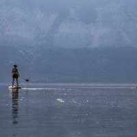 A woman on a paddle board on Kelly Lake in the NWT.