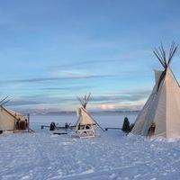 Aurora tours.net three traditional Indigenous teepees on the snow in winter Yellowknife, Northwest Territories.