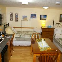 Embleton House B&B heritage suite with a table and a bed in Yellowknife, NWT.