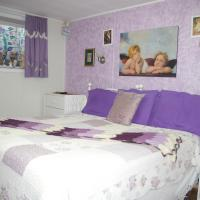 Embleton House B & B angel room bedroom with picture on wall with two cherubs