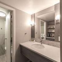 Ptarmigan Inn newly renovated brightly lit bathroom in Hay River, South Slave region.